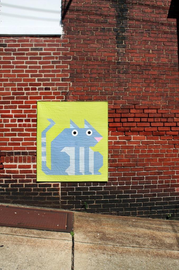 Cat_on_brick_wall_003